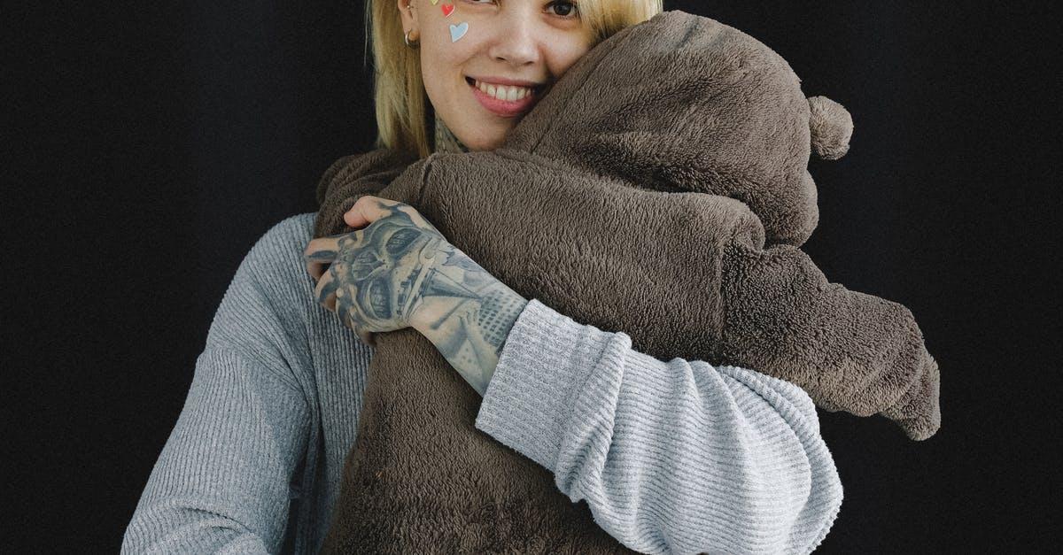 A person holding a teddy bear
